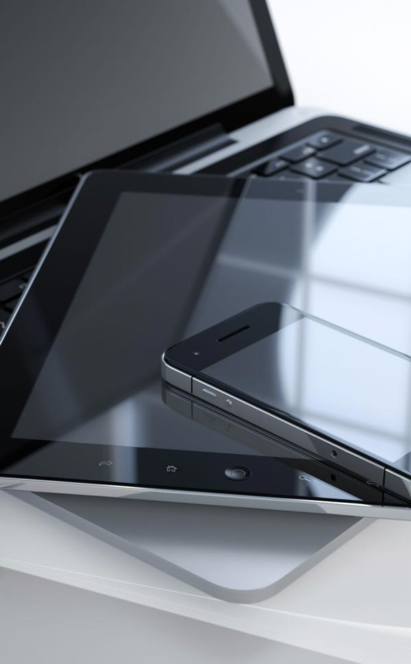 photo of mobile phone tablet and laptop
