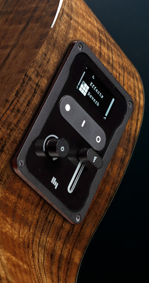 closeup of the HyVibe device attached to side of guitar